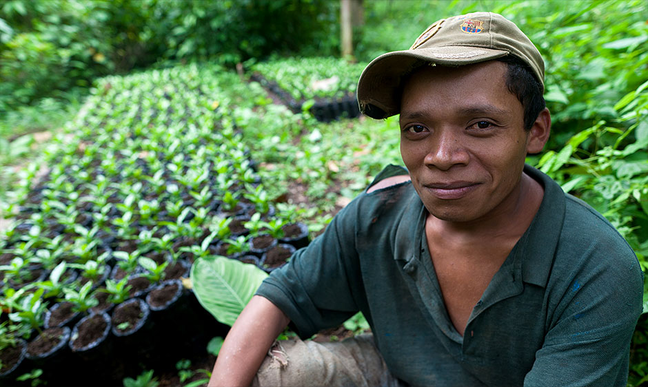 Coffee farmer and coffee seedlings at an Agros International village in Nicaragua.